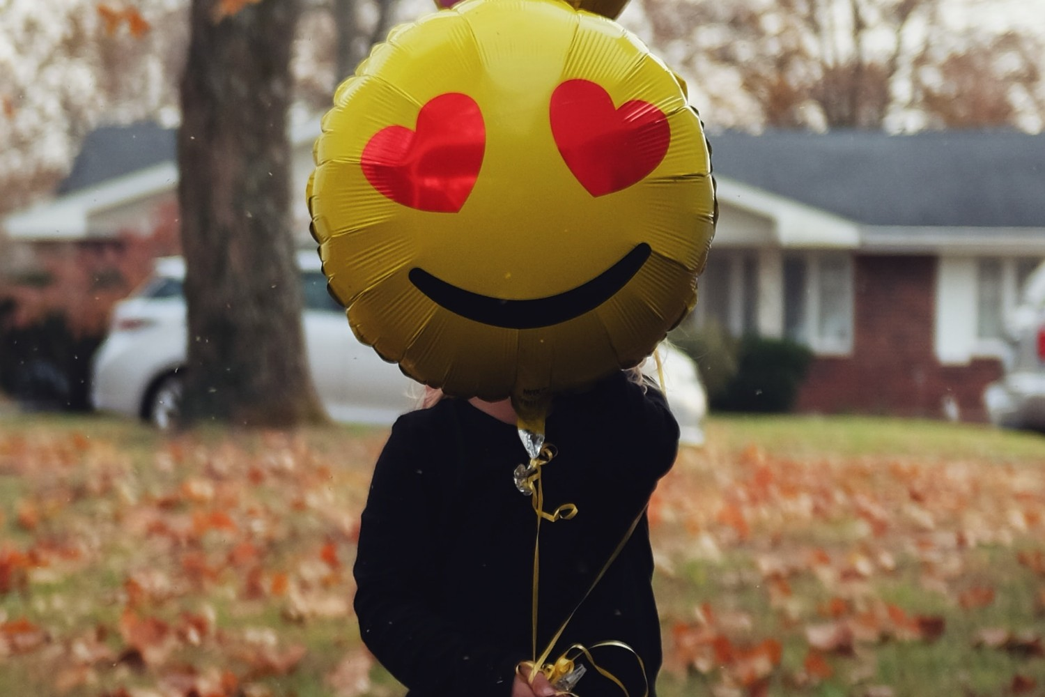 Person with smiley balloon